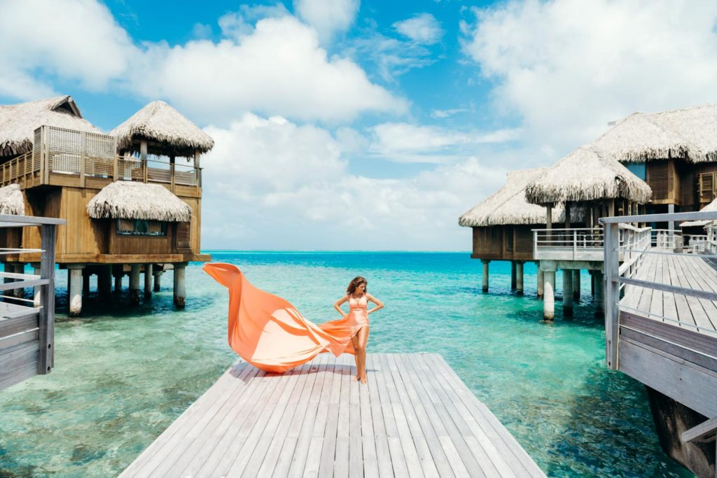 Photoshoot with flying coral dress in Bora Bora