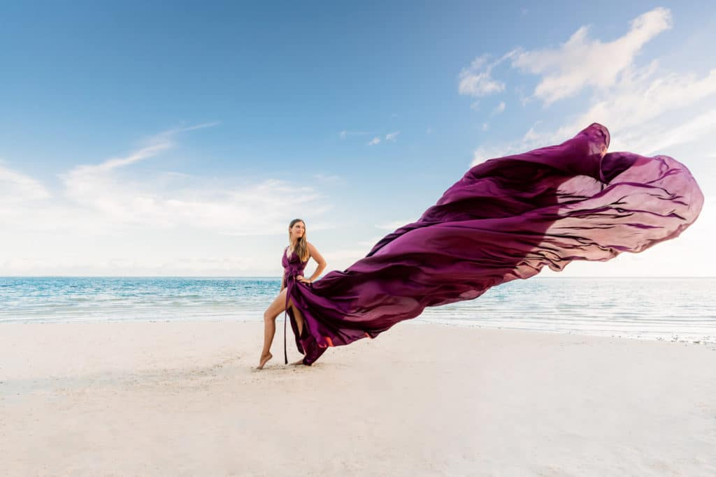 Photoshoot in Bora Bora with maxi purple flying dress