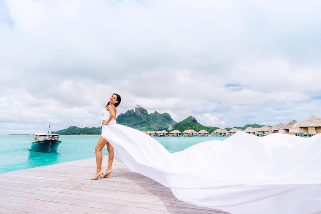 Photoshoot with flying white dress in Four Seasons Bora Bora