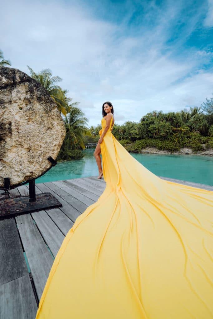 Photoshoot with flying yellow dress in Four Seasons Bora Bora